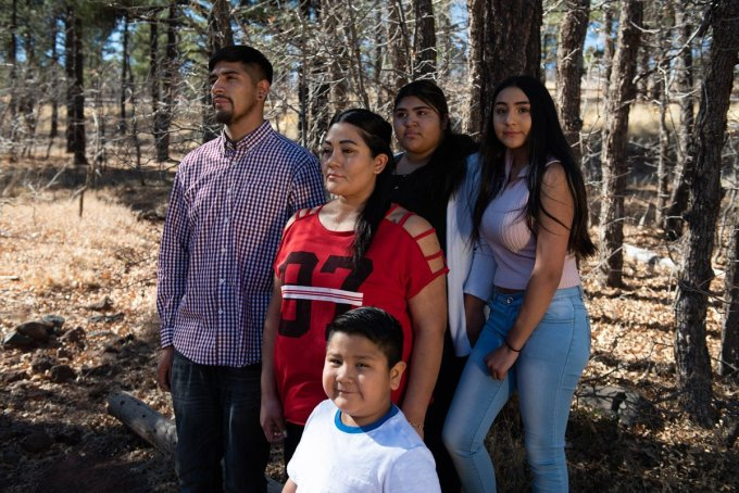 Jose Montelongo poses for a portrait in the woods near Flagstaff with his sister Marisela and her children. All three children were present when ICE agents attempted to arrest Marisela. Ash Ponders for High Country News