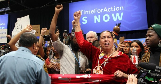 Casey Camp-Horinek, Ponca Nation leader, speaks out during an action inside the UNFCCC COP25 in Madrid. (Photo: Katherine Quaid/WECAN International)