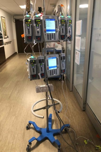A medical provider at Long Island Jewish Medical Center shared a photo of IV poles. Staff extended the dripline so they could monitor the patient's vitals and medication supply from outside the room, rather than inside, to conserve masks and other protective equipment.