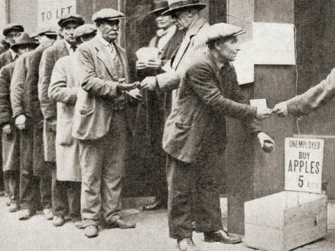 A line of unemployed men buy apples for 5 cents during the Great Depression. (Photo: Universal History Archive/Universal Images Group via Getty Images)