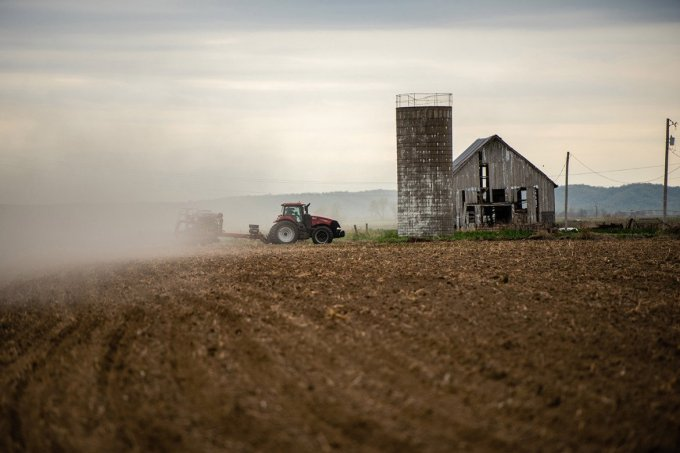 Richard Oswald plants corn on his family's homestead in Atchison County, Missouri. A year ago, his land was feet deep underwater from flooding along the Missouri River.(MISTY PROCHASKA FOR KHN)