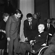 Nick Kotz, left, greets Upton Sinclair at the White House in 1967
