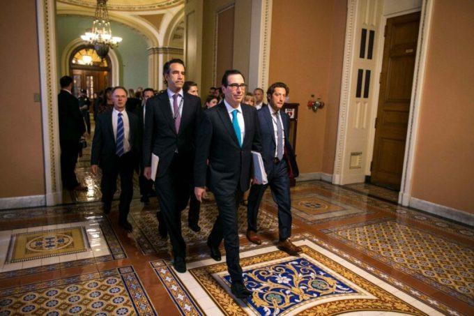 Justin Muzinich, center left, then a top adviser to Treasury Secretary Steven Mnuchin, center, on Capitol Hill on Sept. 12, 2017. (Al Drago/The New York Times/Redux)