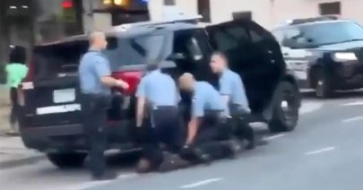 Three police officers kneel on George Floyd during his killing as another stands by. (image: screenshot)