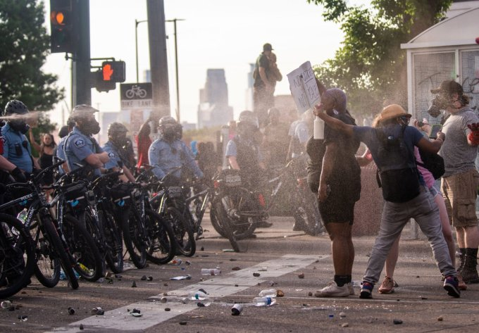 Protesters being shot with pepper spray by police on May 27 in Minneapolis during demonstrations that followed the killing of George Floyd. (Stephen Maturen/Getty Images)