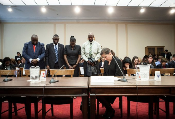 Becky Monroe, far right, then acting director of the CRS, appears before Congress with Trayvon Martin's parents at a forum called after the teenager's death. (Brendan Smialowski/AFP via Getty Images)