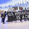 "Protesters holding a banner reading, ""U.S. Immigration Policy Is A Crime"" at a silent protest in January 2020. (Photo: Erik McGregor/LightRocket)"