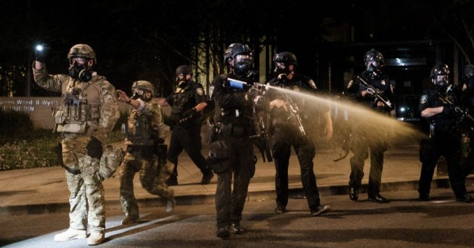 Federal officers use tear gas and other crowd dispersal munitions on protesters outside the Multnomah County Justice Center on July 17, 2020 in Portland, Oregon. (Photo: Mason Trinca/Getty Images)