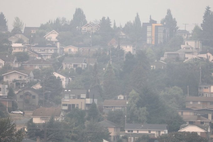 During the summer of 2018, wildfire smoke settles over the North Beacon Hill neighborhood in Seattle, Washington. This year, Seattle officials worry about the effects that smoke could have on residents, and how to safely protect them from both smoke and COVID-19. Matt M. McKnight/Crosscut.com