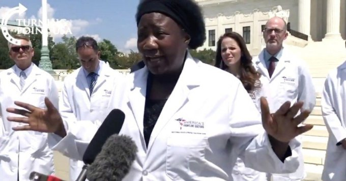 "Dr. Stella Immanuel, of ""America's Frontline Doctors,"" spreads misinformation about the coronavirus in a now-deleted Twitter video from right-wing website Breitbart. (Image: Breitbart/screenshot)"