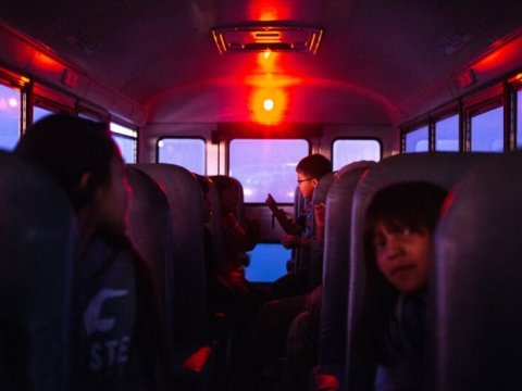 Students on a school bus to Hunters Point Boarding School in St. Michaels, Arizona, one of 180 schools managed by the federal Bureau of Indian Education. BIE-run schools have consistently let down their Native students. (Mark Henle/Arizona Republic)