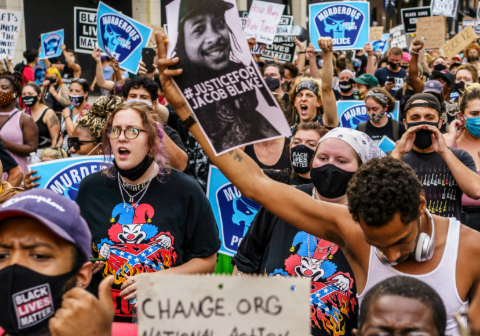 Protesters march near the Minneapolis 1st police precinct during a demonstration against police brutality and racism on August 24, 2020 in Minneapolis. (Photo: Kerem Yucel/AFP)