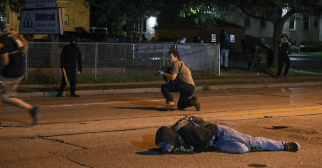 A man on the ground was shot during the third day of protests over the police shooting of Jacob Blake in Kenosha, Wisconsin on August 25, 2020. (Screenshot. Photo: Tayfun Coskun/Anadolu Agency via Getty Images)