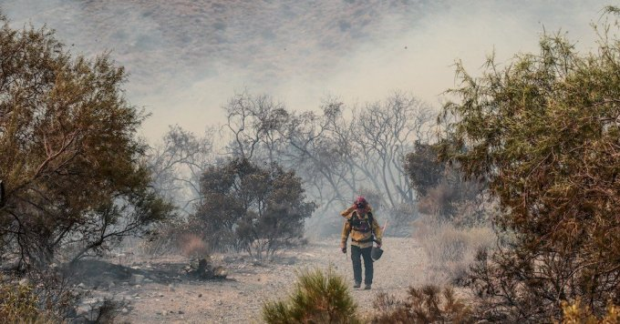 Smoldering brush remains after fire swept through the Whitewater Preserve Trail in the San Gorgonio Mountains in California on August 2, 2020. (Photo: Robert Gauthier/Los Angeles Times via Getty Images)