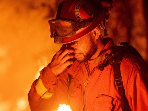 An inmate firefighter pauses during a firing operation in California in 2018. This year, as the state is engulfed in wildfire smoke and flames, Covid-19 has complicated the state's fire supression response as well as its practice of using prison labor to fight the blazes. (Photo: Josh Edelson/AFP)