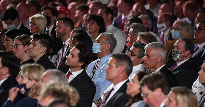 Guests, a few wearing masks, watch U.S. President Donald Trump deliver his acceptance speech for the Republican Party nomination for reelection during the final day of the Republican National Convention from the South Lawn of the White House on August 27, 2020 in Washington, D.C. (Photo: Saul Loeb/AFP)