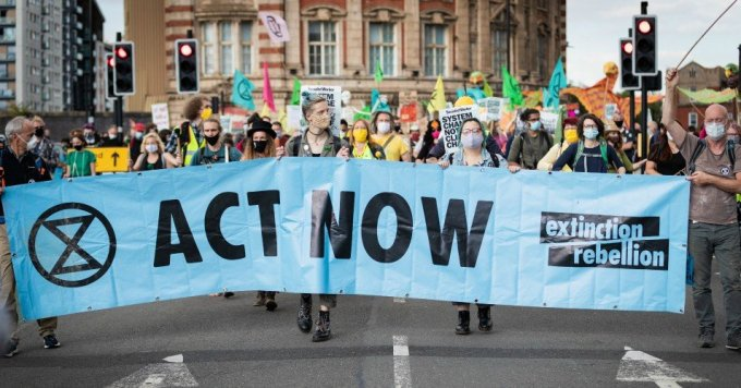 """Protesters march with a banner during a demonstration in Manchester, United Kingdom on September 1, 2020. The Northern Rebellion, which is part of the Extinction Rebellion movement, took to the streets for a multi-day action under the slogan """"We Want To Live."""" (Photo: Andy Barton/SOPA Images/LightRocket)"""