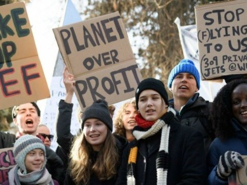 "Swedish climate activists Greta Thunberg, Luisa Neubauer, Isabelle Axelsson, and Vanessa Nakate take part in a ""Friday for Future"" youth demonstration in a street of Davos on January 24, 2020 on the sideline of the World Economic Forum (WEF) annual meeting. (Photo: Fabrice Coffrini/AFP via Getty Images)"