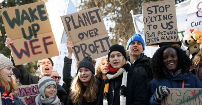 """Swedish climate activists Greta Thunberg, Luisa Neubauer, Isabelle Axelsson, and Vanessa Nakate take part in a """"Friday for Future"""" youth demonstration in a street of Davos on January 24, 2020 on the sideline of the World Economic Forum (WEF) annual meeting. (Photo: Fabrice Coffrini/AFP via Getty Images)"""