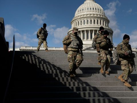 National Guard soldiers patrol the Capitol grounds in Washington, D.C., on March 6. Credit: Brendan Smialowski/AFP via Getty Images
