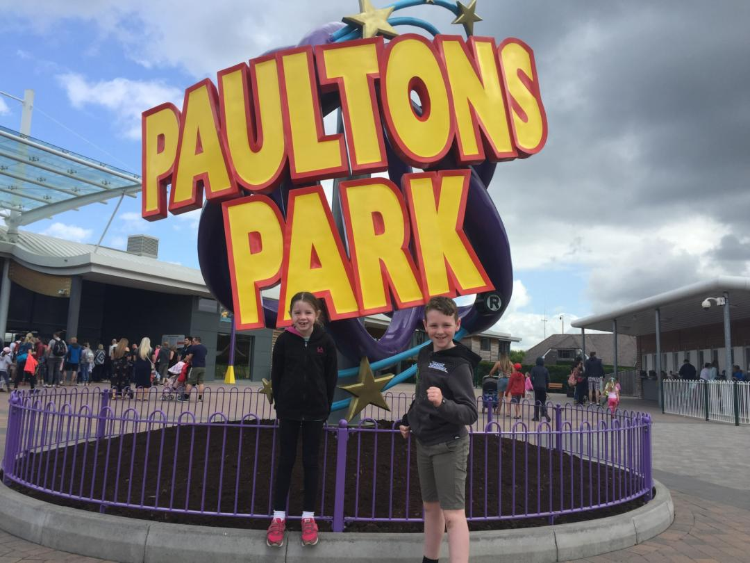 My older kids at the Paultons Park sign