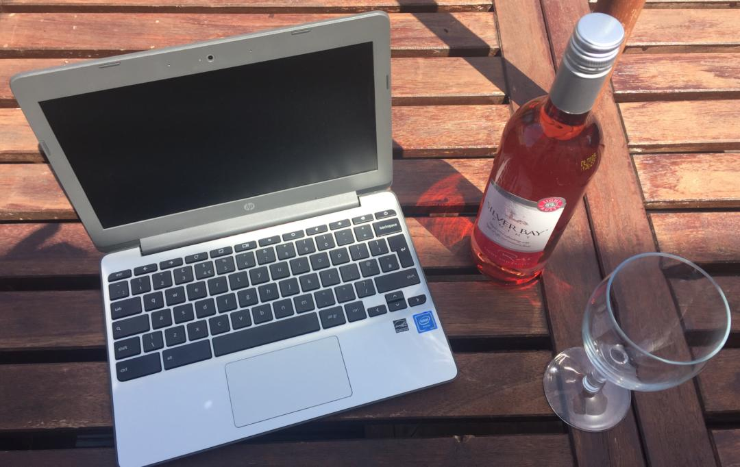Work at home mum garden set up, laptop wine and glass