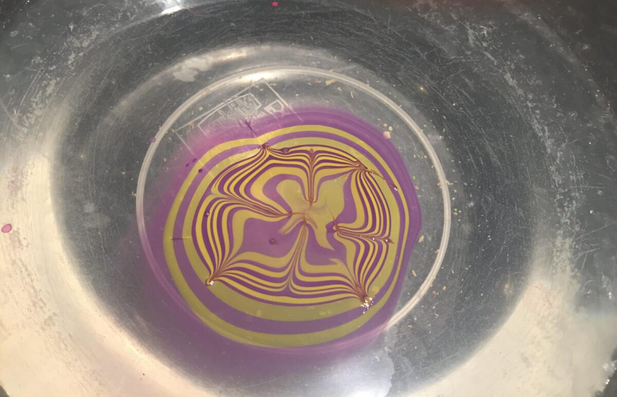 The marbled nail Polish floating on the water
