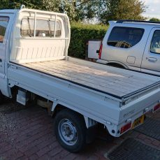 Suzuki Carry DD51T carrying log burner fuel bricks