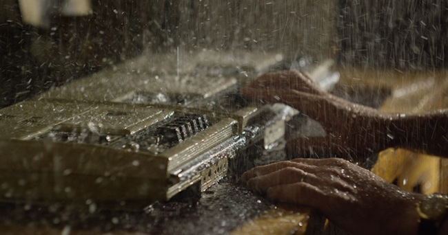 rain falling on a cassette-player and recorder in Notes on Blindness 2016 film
