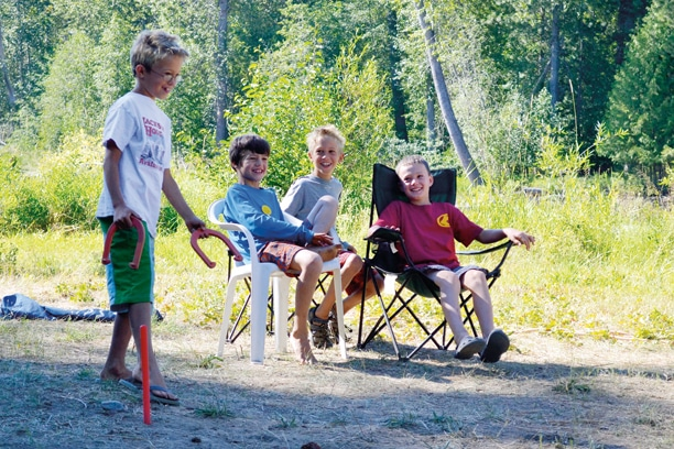 Horseshoes players Carter Sheley, left, Sawyer Crandall, Graham Sheley and Eamon Monahan, took life easy at Little Star's Archery Camp. Photo by Laurelle Walsh