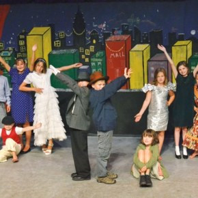 """The Merc Playhouse wrapped up a week-long drama camp Friday (Aug. 9) with scenes from the Broadway musical Annie. Seventeen kids honed their song, dance and acting skills, and designed set pieces and costumes under the tutelage of guest director Megan Fox Hicks. Here, from left, Travis Grialou, Sage Borgias, Isabelle Horan, Peter Nourse, Seth Kurtz, Wyatt Belcher, Julia Dietz, Emma Nourse, Wyatt Albright and Olivia Morrow peform """"It's a Hard Luck Life."""" Photo by Laurelle Walsh"""
