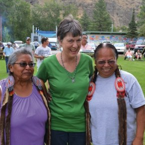 Powwow organizer Carolyn Schmekel thanked sisters Teena Paul, left, and Mitzi Nanamkin, both of Nespelem, who shared a prayer before Saturday's shared meal. Photo by Laurelle Walsh