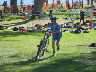 Liv Aspholm pushes her mountain bike toward the starting line for the 13.1-mile bike race, the second leg of the ChelanMan Try-A-Tri. Photo courtesy of David Aspholm
