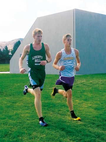 Junior Willy Duguay overtakes a Hanford competitor en route to his 29th-place finish at the Wenatchee Invitational last weekend. Photo courtesy of Jennifer Duguay