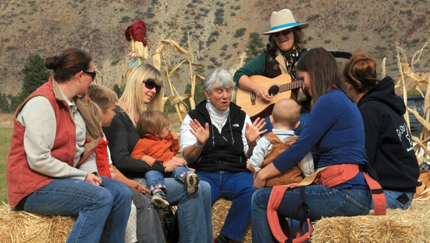 "Lauralee Northcott led a rousing chorus of ""Don't Fence Me In"" on a hayride for kids and adults at the fourth-annual Pumpkin Festival on the Gold Creek Loop, which drew some 300 people to celebrate the harvest."