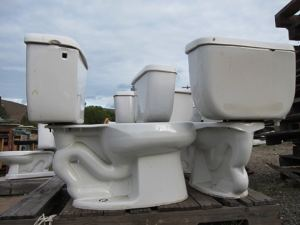 Toilets waiting for a new home are among the varied collection of used building materials that have been available at Methow Resource Recovery, which is closing Oct. 19. Photo by Don Nelson