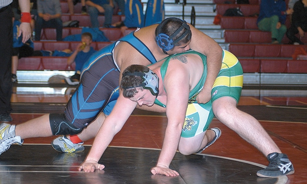 Junior Stoney Hulon, wrestling in the 285-pound division, pinned Joseph Lopez of Tonasket in the second round of last weekend's Omak Tournament. Photo by Mike Maltais