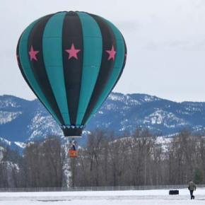 The Outer Limits balloon landing at North Cascades Smokejumper Base north of Twisp with second crew chief, Steve Justice, running to grab the anchor tether. Photo by Darla Hussey