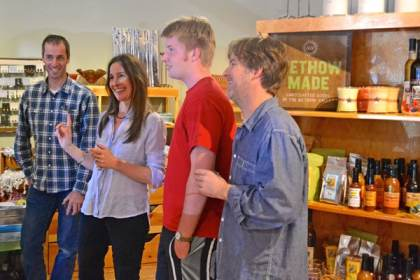 Hannah Cordes, new owner of Aspen Grove, and her brother Tim, left, son Isaac and husband, Bob, greet visitors at the store's reopening on Sunday. Photo by Laurelle Walsh