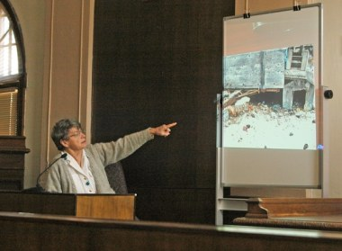 Photos of the location the dog was originally found were used during the trial. Here Judy Brezina Camp points to one displayed during her testimony. Photo by Ann McCreary