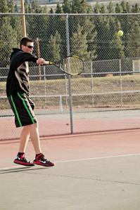 Josh Frey returns a serve against an Oroville opponent at Liberty Bell last week. Frey won the pro set, 8-1. Photo by Mike Maltais