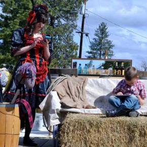 Jamie Jensen and son Noah Mathews on the Evergreen IGA float. Photo by Laurelle Walsh