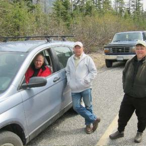 Ed Maher of Mazama (in the car) was the first person in line at the   Silver Star Gate on Thursday. Gene Galipeau, center, of Stanwood, was   fourth in line and was on the last leg of a 22-day, 10,000-mile tour   of Western states. Gary Thomas of Nooksack was second in line. Photo by Don Nelson