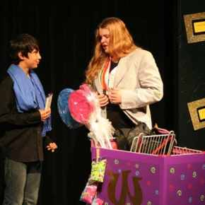 Wonka (Morgan Tate, right) goes to great lengths to make sure Charlie (Myles Davis) gets just the right Wonka bar. Photo by Darla Hussey