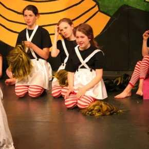 The Oompa-Loompas are relieved to remove the wigs after the production is over. Photo by Darla Hussey