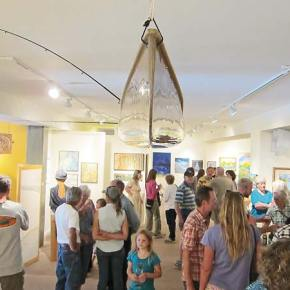 "Confluence Gallery was jammed for the opening of the ""Our River"" exhibit. Photo by Don Nelson"