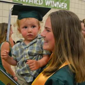 Rainier Sanders (in mortarboard), Liberty Bell High School class of 2029, shares the moment with his aunt Kathleen Chavey-Reynaud, class of 2014. Photo by Laurelle Walsh