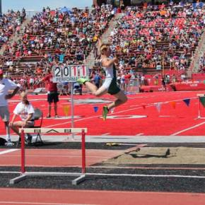 Austin Watson leaps to victory. Photo by Lauren Fitzmaurice