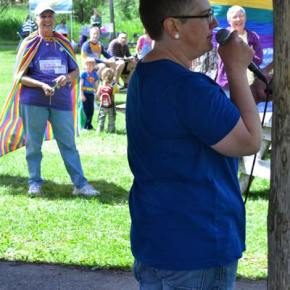 """Event organizer April Wertz speaks to a rapt audience about the need for events like Methow Valley Pridefest. """"We celebrate today to recognize those who came before us…. We come together to show the world that we are here. We exist."""" Photo by Laurelle Walsh"""