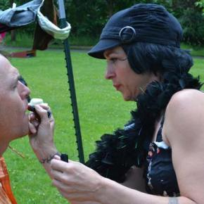 Makeup artist Jessica DaCosta gives competitor Clark Youmans a 60-second makeup application during the Drag King/Drag Queen race. Photo by Laurelle Walsh